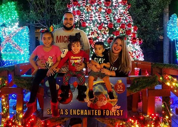 Santa's Superfan Family Photo at Peppermint Christmas Tree